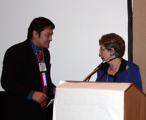 JALT's Steven Nishida receives Virginia French Allen award, on behalf of Mary Goebel Noguchi, from Penny Alatis
