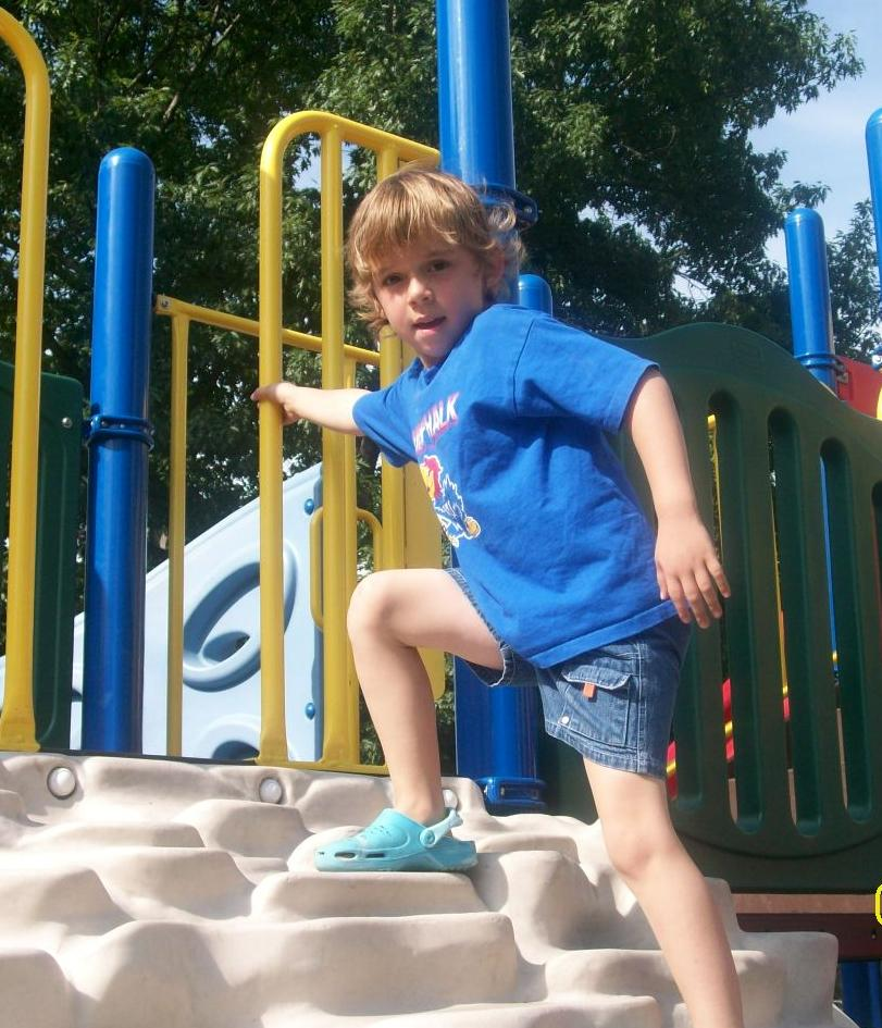William John Scott, climbing the jungle gym at the playground in City Park, Manhattan, KS, June 2009